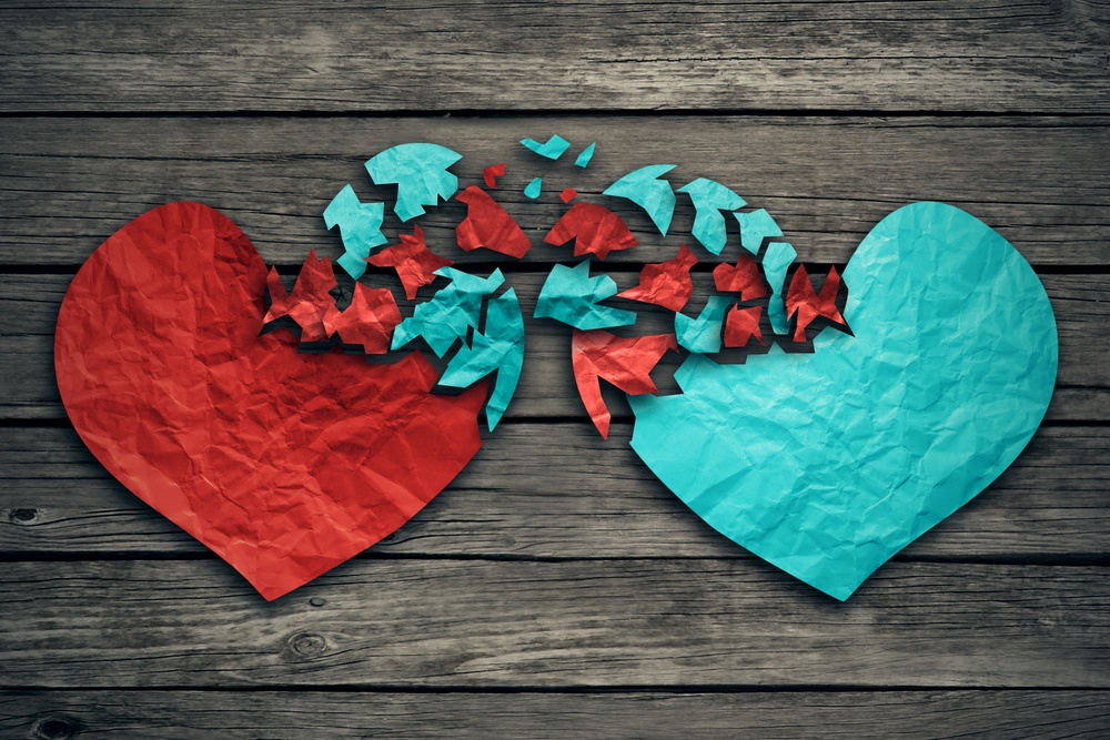 Romantic relationship concept as two hearts made of torn crumpled paper on weathered wood as symbol for romance attachment and exchange of feelings and emotions of love..jpeg